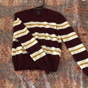 maroon sweater with white & yellow stripes.